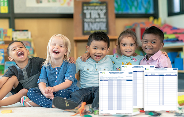 Smiling children hugging in preschool with images of the 3 Stages Behavior Management Forms in the bottom corner of image