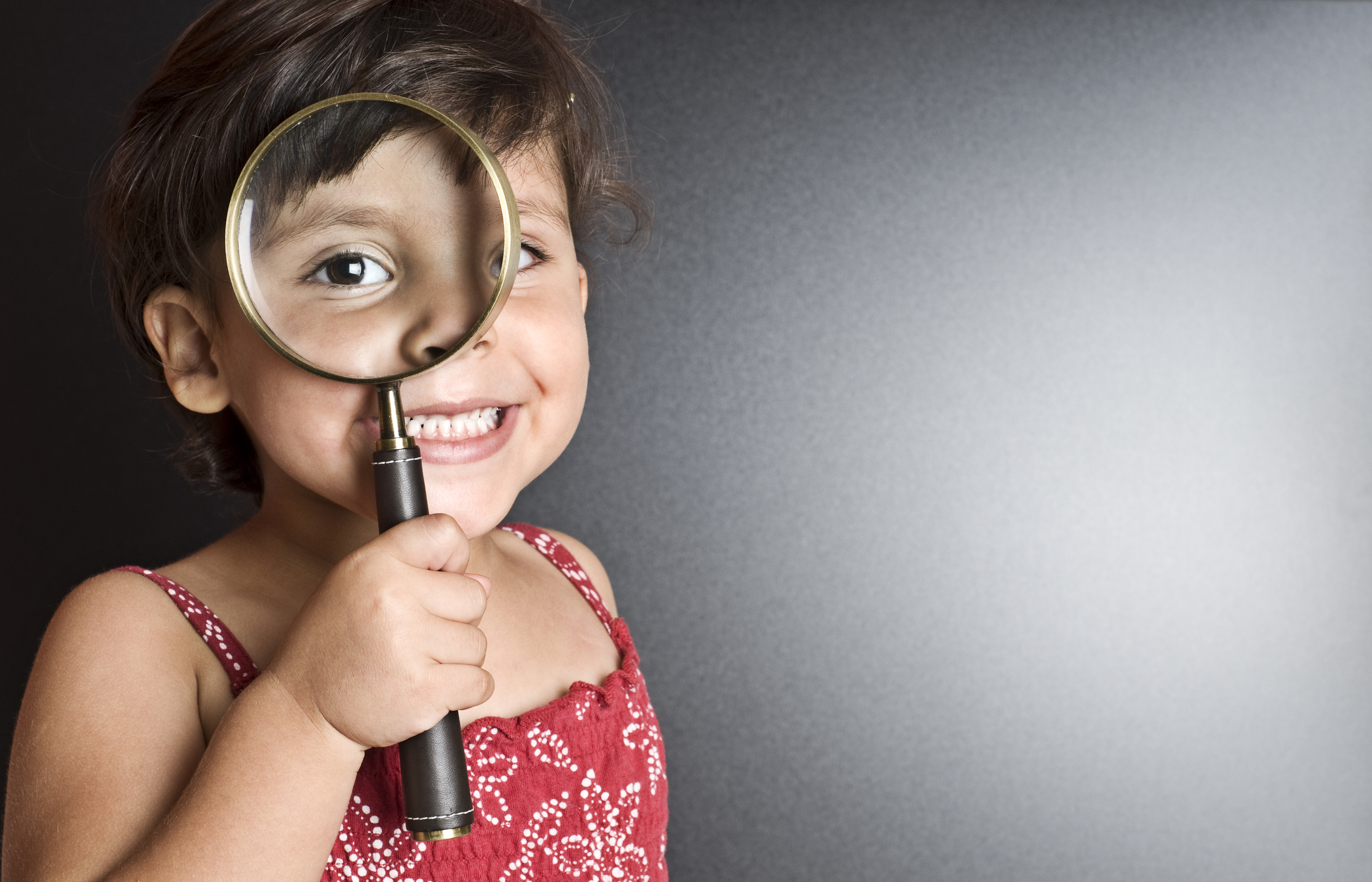 Smart Girl with magnifying glass